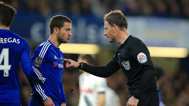 Referee Mark Clattenburg (right) makes his point to Chelsea's Eden Hazard (left).