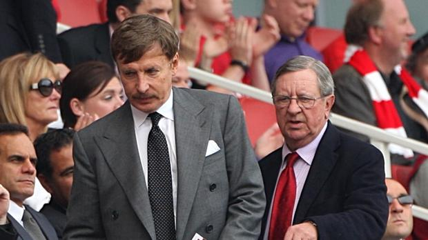 Stan Kroenke (left) has increased his majority shareholding in Arsenal