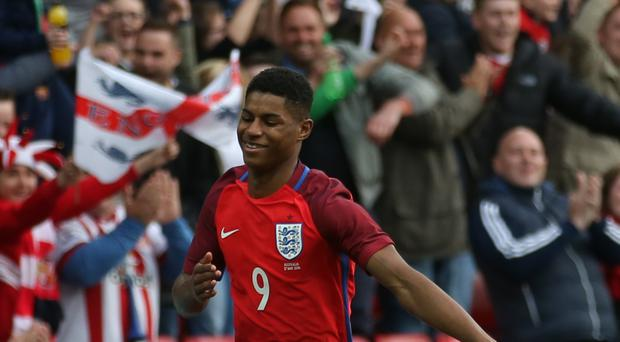 Marcus Rashford celebrates scoring on his England debut against Australia on Friday.