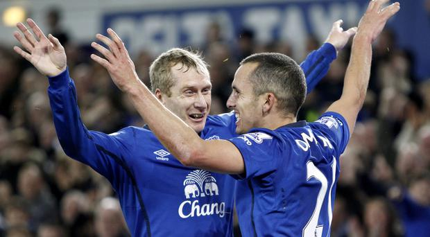 Tony Hibbert (left) and Leon Osman have been released by Everton.