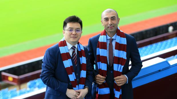 New Aston Villa chairman Dr Tony Xia welcomes boss Roberto Di Matteo to the club on Wednesday.