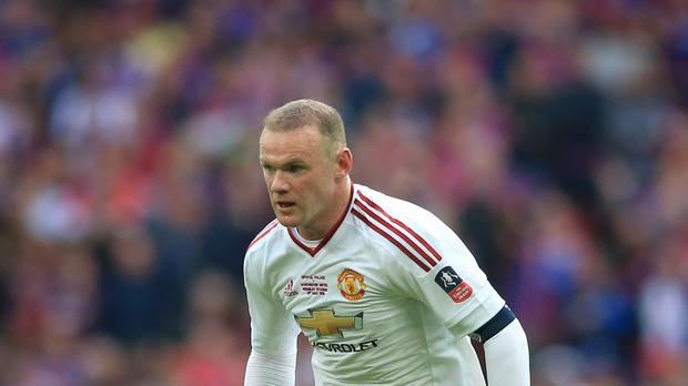 Wayne Rooney could see out his playing days at Manchester United