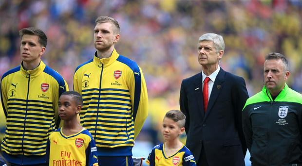 Goalkeeper Wojciech Szczesny (far left) hopes manager Arsene Wenger remains at Arsenal, amid reports of interest from the FA over the vacant England job