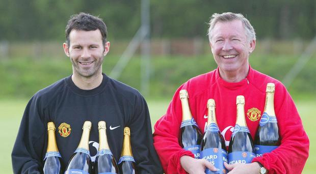Sir Alex Ferguson (right) has backed Ryan Giggs (left) to make his mark as a manager away from Manchester United