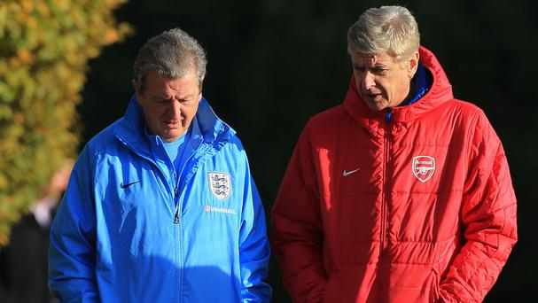 The FA is reportedly keen to talk to Arsenal manager Arsene Wenger, right, about replacing Roy Hodgson, left, as England manager