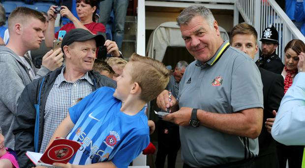 Sam Allardyce signs autographs ahead of what is expected to be his last game before becoming England manager