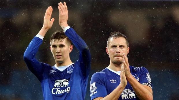 Everton's Phil Jagielka and John Stones (left) will miss the first pre-season friendly at Barnsley.
