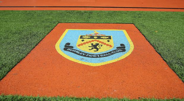 A Burnley supporter has been banned following an incident of alleged racist abuse at Bradford on Saturday