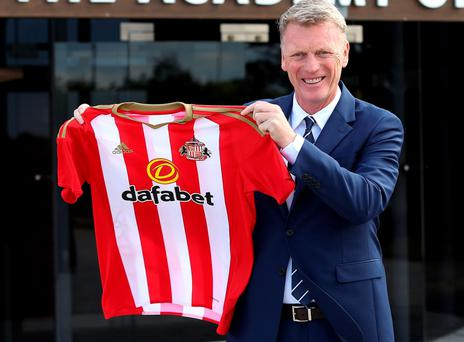 New job: David Moyes grins after his first press conference as Sunderland boss