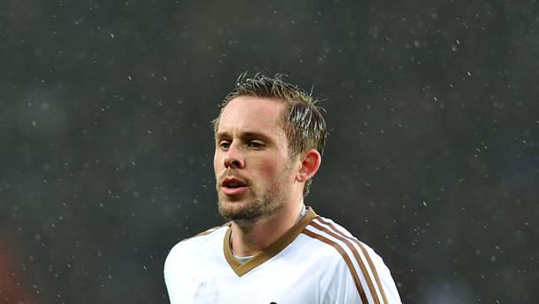 Swansea's Gylfi Sigurdsson has signed a new four-year deal at the Liberty Stadium.