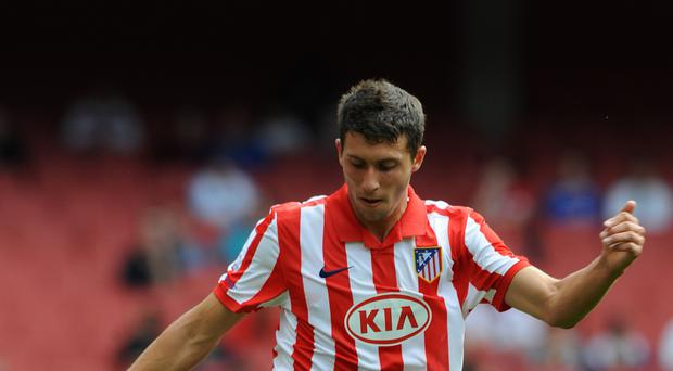 Atletico Madrid striker Borja Baston is set to become Swansea's club-record signing