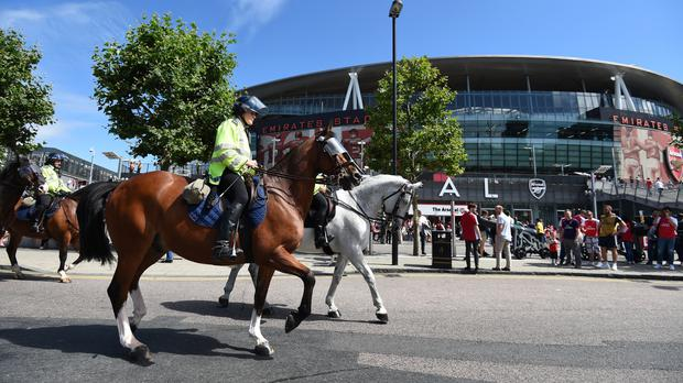 Mounted police make their way past the Emirates Stadium