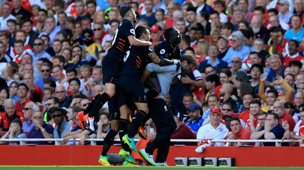 Jurgen Klopp, right, celebrated with his Liverpool players as they went 4-1 up at Arsenal