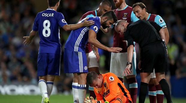 West Ham goalkeeper Adrian exchanges words with Chelsea's Diego Costa