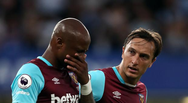 Andre Ayew, left, is consoled by West Ham captain Mark Noble after suffering a thigh injury against Chelsea