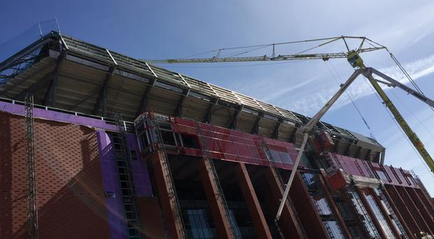 Liverpool will play at Anfield, with its redeveloped Main Stand, for the first time this season on September 10