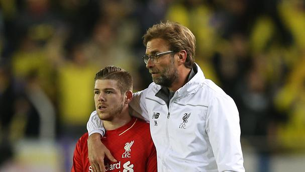 Liverpool manager Jurgen Klopp (right) has brushed off criticism of left-back Alberto Moreno.