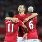 Zlatan Ibrahimovic, centre, netted a brace as Manchester United remained on maximum points at the top of the Premier League