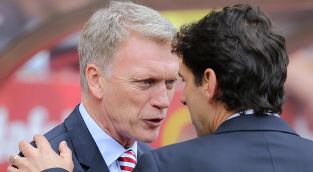 Sunderland manager David Moyes, left, expects another relegation scrap