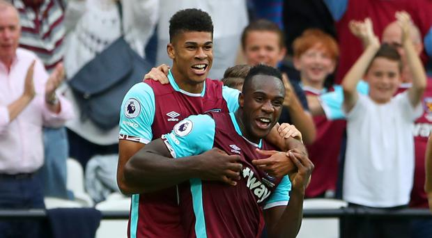 Michail Antonio, pictured right, scored the first Premier League goal at the London Stadium