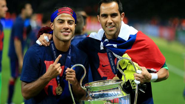 Claudio Bravo, right, looks set to join Manchester City from Barcelona