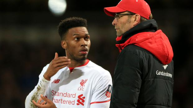 Liverpool boss Jurgen Klopp, right, has no issue with Daniel Sturridge, left, not wanting to play out wide