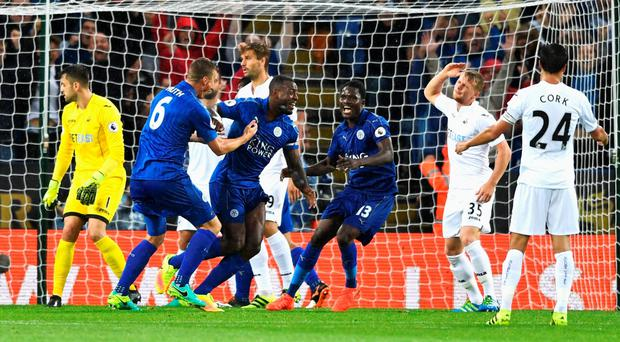Captain's role: Wes Morgan after netting Leicester's winner