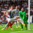 In control: West Brom's Jonny Evans clears under pressure