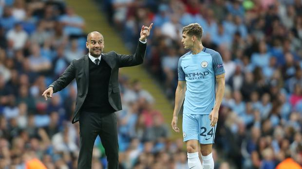England defender John Stones, right, is already learning from his Manchester City Pep Guardiola
