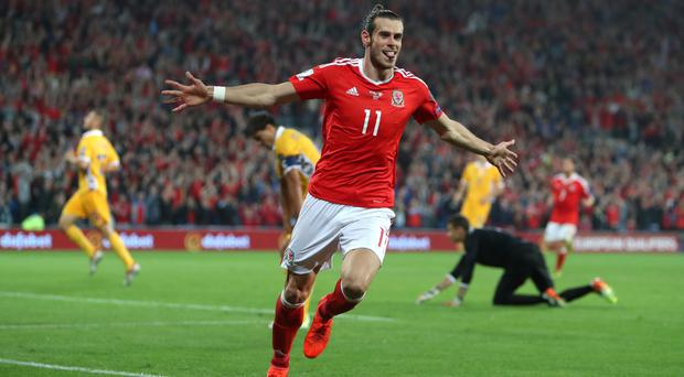 Gareth Bale brushed off the physical treatment to score twice against Moldova