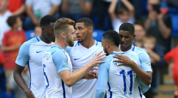 England Under-21 striker Marcus Rashford (far right) celebrates his first goal against Norway with Nathan Redmond (second form right) and his team-mates