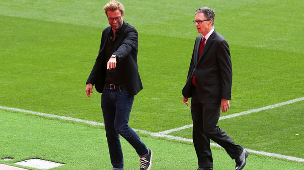Liverpool manager Jurgen Klopp (left) with owner John Henry ahead of the opening of the Anfield Main Stand which they believe will help close the gap on their rivals.