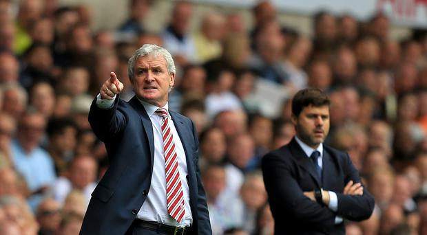 Stoke manager Mark Hughes, pictured left, has been credited with changing the club's tactical approach by Tottenham counterpart Mauricio Pochettino