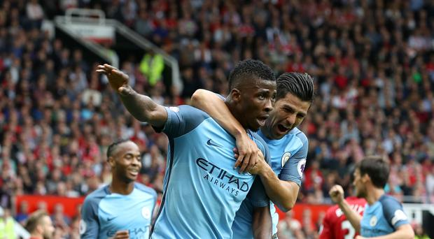 Manchester City's Kelechi Iheanacho (left) celebrates scoring his side's second goal of the game with team-mate Nolito (right).