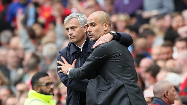 Pep Guardiola (right) saw his City side beat Jose Mourinho's United