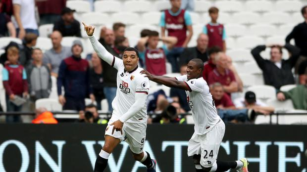 Watford's Troy Deeney (left) celebrates scoring his side's second goal of the game against West Ham