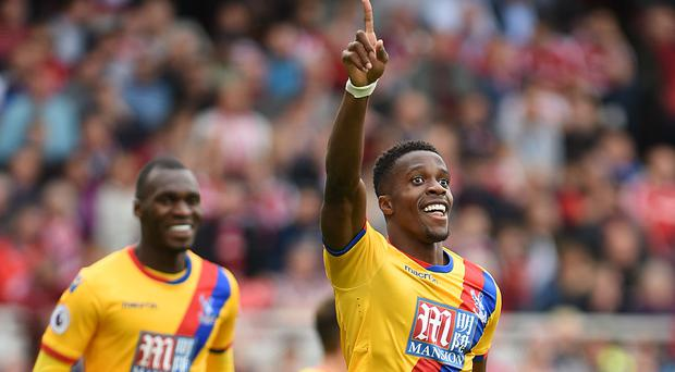 Crystal Palace forward Wilfried Zaha (right) celebrates the winner at Middlesbrough