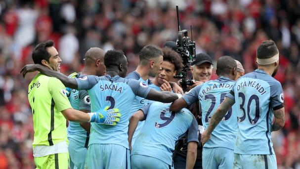 Manchester City's players celebrate their 2-1 derby win at Manchester United on Saturday.