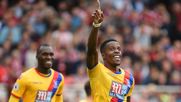 Crystal Palace forward Wilfried Zaha (right) celebrates scoring his winning goal at Middlesbrough