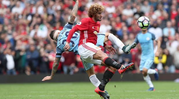 Marouane Fellaini and Manchester United lost Saturday's cross-city battle