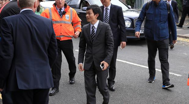 Tony Pulis doies not expect Guochuan Lai (centre) to change much at West Brom