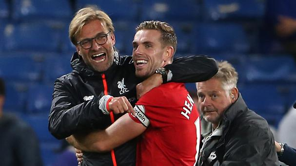 Star man Jordan Henderson celebrates with boss Jurgen Klopp after the final whistle
