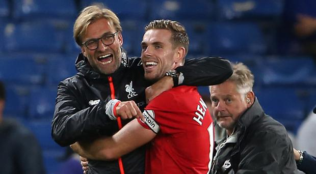 Liverpool manager Jurgen Klopp, left, celebrated with goalscorer Jordan Henderson after their win at Chelsea