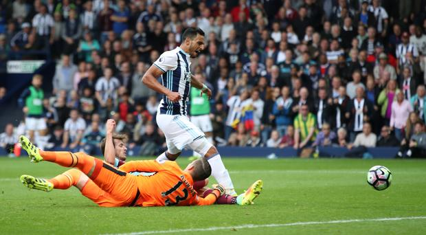 Nacer Chadli, right, scores West Brom's fourth goal