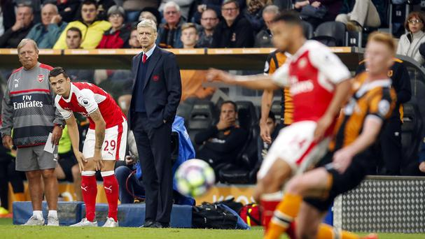 Arsene Wenger watches on during Arsenal's win over Hull