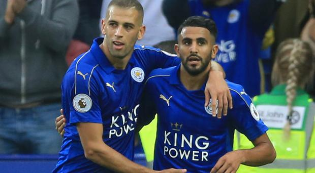 Leicester City's Riyad Mahrez (left) and Islam Slimani celebrate the Foxes' third goal in their 3-0 win over Burnley.