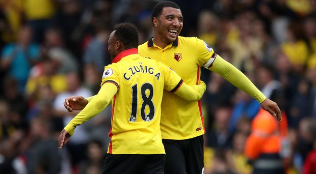 Troy Deeney, right, and Camilo Zuniga celebrate victory after the final whistle