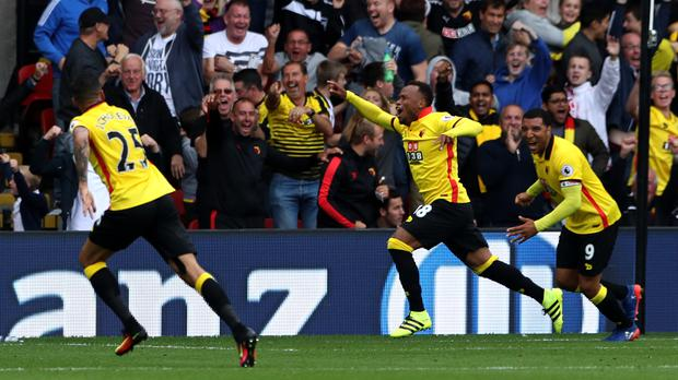 Camilo Zuniga, centre, celebrates scoring Watford's second goal of the game