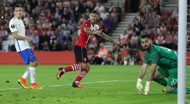 Charlie Austin, centre, came off the bench to power Southampton to victory over Swansea