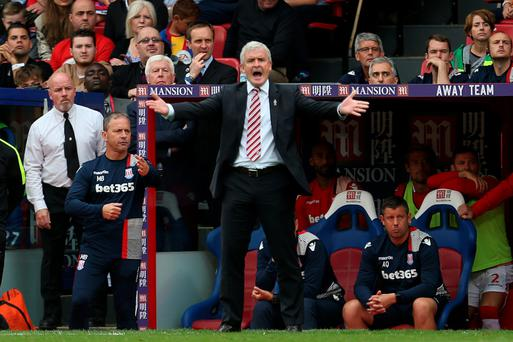 Up in arms: Mark Hughes and Stoke have had a horror start